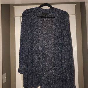 Navy and white specked cardigan.
